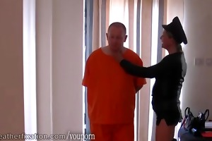 dom leather clad femdom-goddess spanks prisoner
