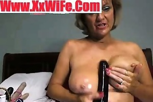 breasty oiled granny getting undressed and