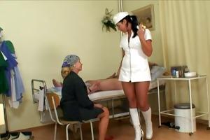 nubile nurse receives a show