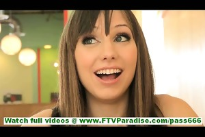 risi cute brunette hair with wide smile flashing
