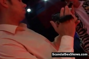 older playgirl plays with sex tool on stage