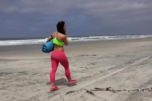 fitness pro does undressed yoga on beach