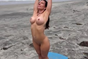 fitness pro does stripped yoga on beach