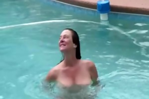 wife having sex with spouse by swimming pool