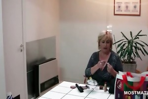 office lady teasing her older scoops with a banana