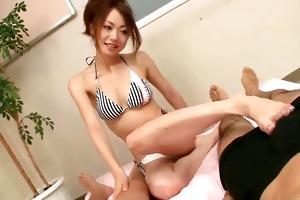 sara seori uses her beautiful feet to caress knobs