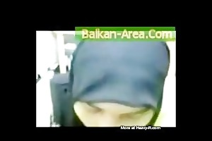 devout pakistani wife in dark burqa engulfing