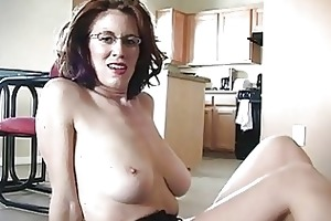 sporty busty redhead momma works on her dick